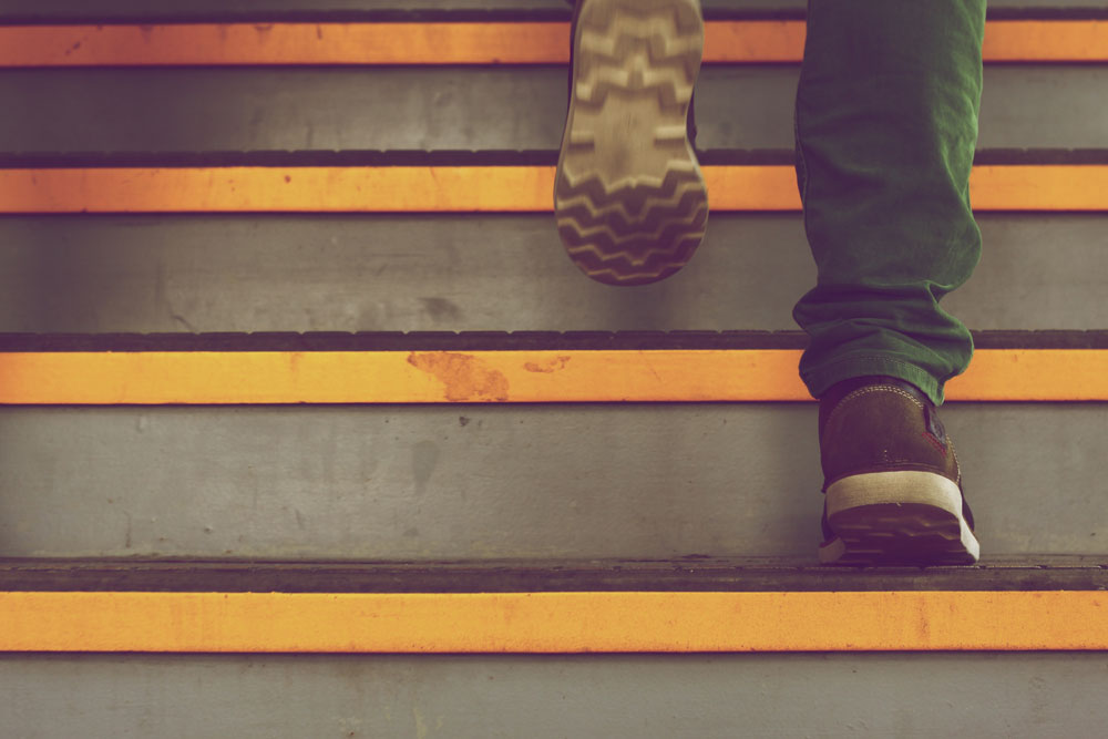 picture of a person climbing steps